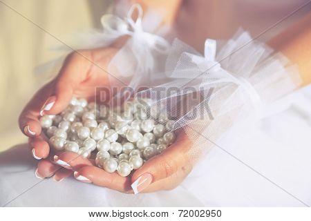 Wedding gloves on bride hands, close-up