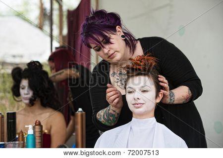 Stylist Fixing Hair