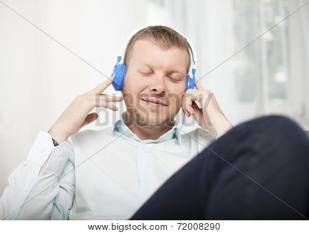 Man Closing His Eyes As He Listens To Music