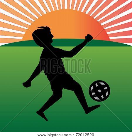 Boy Playing Football In Playfield