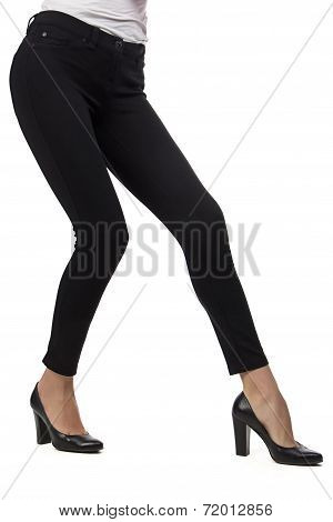 Woman's legs in black pants
