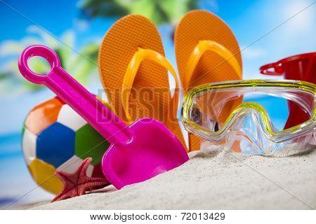Colorful flip flops on beach