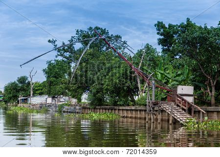 Old Fishnet In Thai Style House Next To River