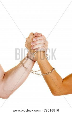 Man And Woman Arm Wrestle With Handcuffs On