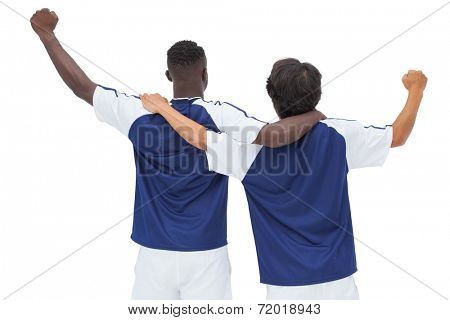Football players celebrating a win over white background