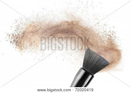 makeup brush with powder foundation isolated on white