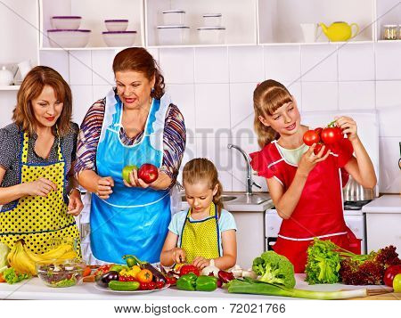 Happy family with child cooking at kitchen. Grandfather and grandmother. kitchen.