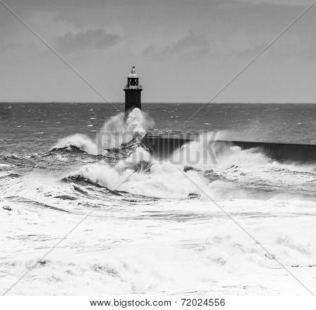 Powerful Waves Crash Over Lighthouse