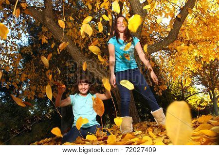 Playful Children With Colorful Fall Leaves Outdoors