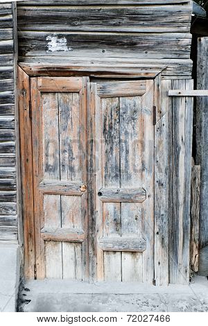 Ancient wooden door. Wooden door of old barn