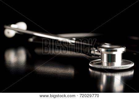 Medical Stethoscope On A Reflective Surface
