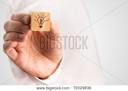 Man Holding A Cube With A Hand-drawn Light Bulb