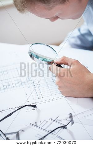 Engineer Analyzing The Plan