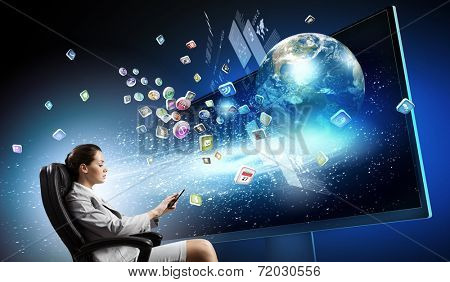 Young businesswoman in chair near tv screen with click. Elements of this image are furnished by NASA