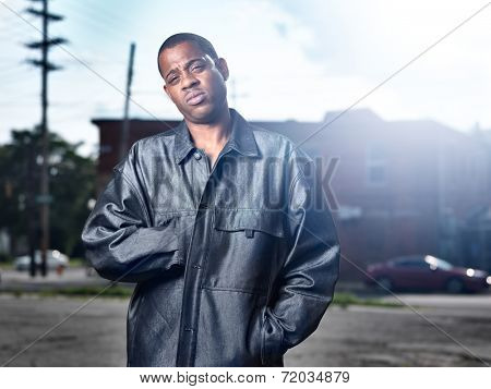 funky African man in ghetto with lens flare