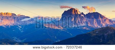 Great view on the Sassolungo (Langkofel) and Sella group, valley Gardena. National Park Dolomites, South Tyrol. Location Ortisei, S. Cristina and Selva, Italy, Europe. Dramatic sunlight. Beauty world.