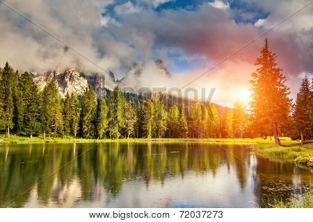 Great view of the foggy Lago Di Antorno in National Park Tre Cime di Lavaredo. Cadini di Misurina Range, Dolomites, South Tyrol. Location Auronzo, Italy, Europe. Dramatic overcast sky. Beauty world.