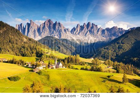 Countryside view of the St. Magdalena or Santa Maddalena in the National Park Puez Odle or Geisler summits. Dolomites, South Tyrol. Location Bolzano, Italy, Europe. Dramatic morning. Beauty world.