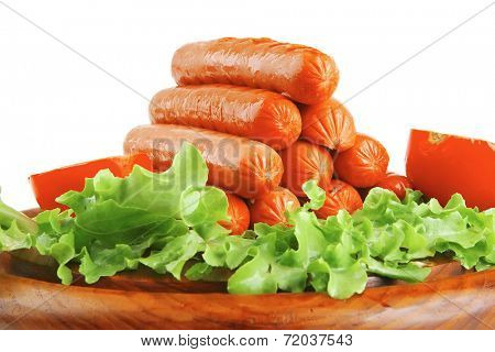 beef grilled sausages served on plate with vegetables