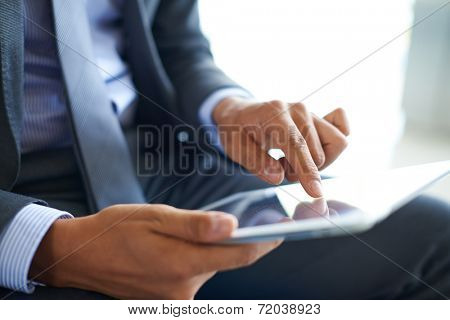 Businessman forefinger pointing at document in touchpad