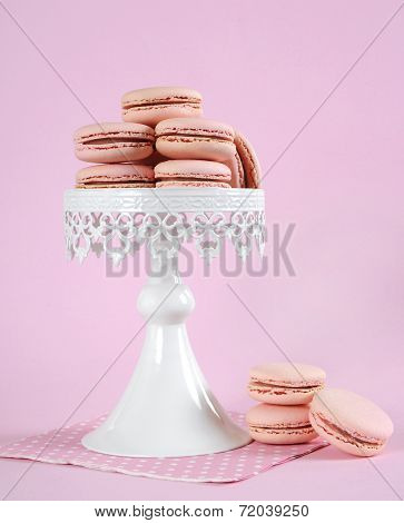 Pink Macarons On White Vintage Style Cake Stand Against Pale Pink Background. Vertical,