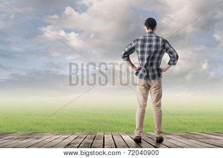 Asian man against grassland with copyspace.