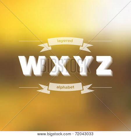 W X Y Z Flat Layered Alphabet On Blurred Background