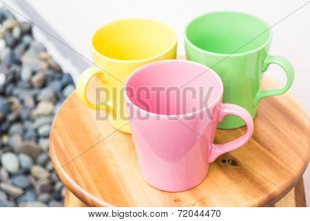 Beautiful Color Mug Cups On Wooden Table