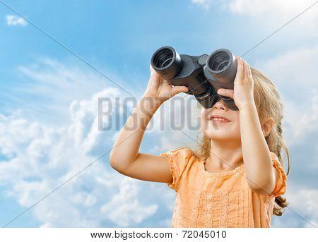 little girl looking through binoculars