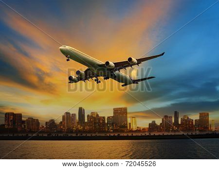 Passenger Plane Flying Above Urban Scene Use For Convenience Air Transport And Logistic Cargo By Air