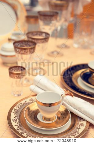 Set of fine bone porcelain dishware, shallow focus, toned image