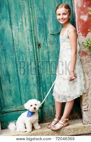 Portrait of lovely girl with Maltese dog