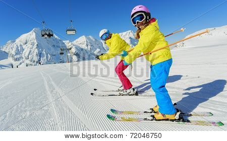 Skiing, winter sport, ski lesson - happy skiers on mountainside