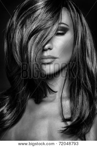 Black and white photo of seductive woman with closed eyes, stylish makeup and hairstyle, luxury photoshoot of super model