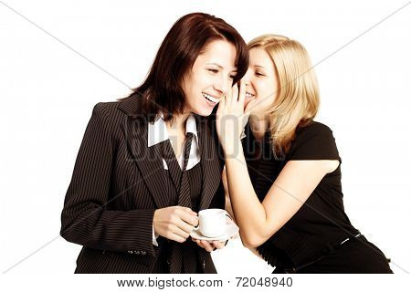 Business gossip. Women in the office. Two girls discuss the news at lunchtime with coffee. Gossip, rumors, secrets and intrigue
