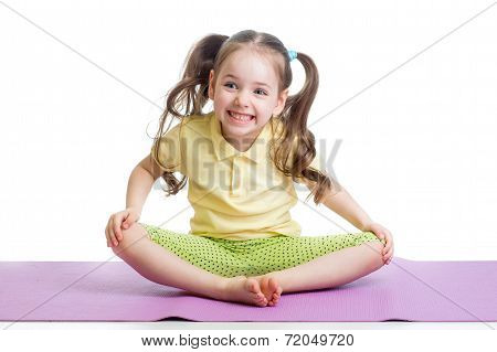 Cheerful Kid Girl Doing Exercises On Fitness Mat
