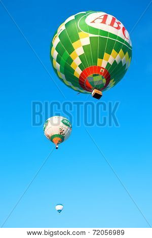 Three flying balloons