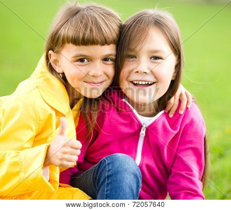 Two Girls Holding Face In Disbelief