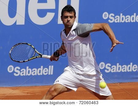 BARCELONA - APRIL, 24: Spanish tennis player I�±igo Cervantes in action during a match of Barcelona tennis tournament Conde de Godo on April 24, 2014 in Barcelona