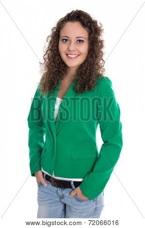 Isolated smiling young business woman in green blazer with jeans.