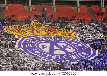 VIENNA, AUSTRIA - SEPTEMBER 18 Fans of FK Austria Wien show a huge flag at a UEFA Champions League game on September 18, 2013 in Vienna, Austria.