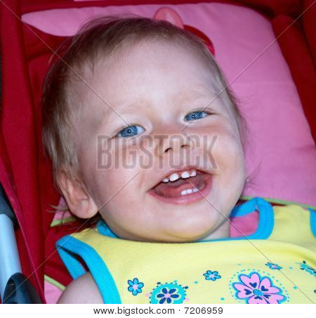 Smiling Baby Girl In A Pram