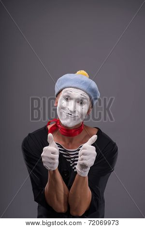 Portrait of male mime white funny face and emotions isolated on