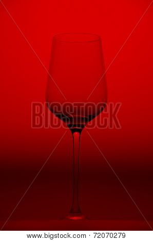 Wine glass on red background