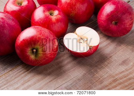 Red Apples On The Wooden Table