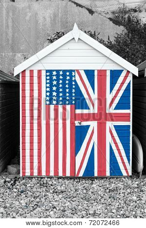 Beach hut featuring the Stars and stripes and union jack painted on the front