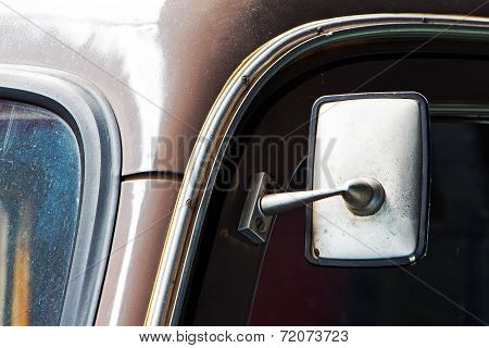 Part Of Old Dusty Car And The Car Mirror