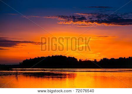 Amazing sunset over lake. Ukraine