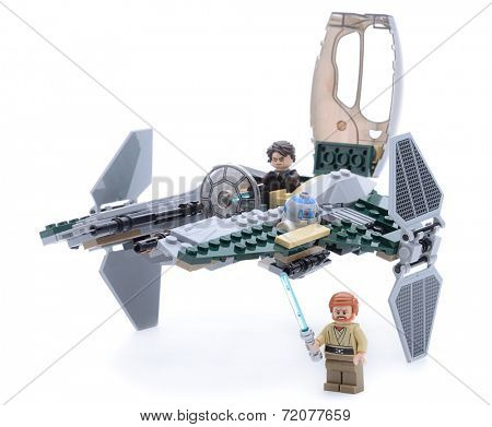 Ankara, Turkey - May 23, 2013: Lego Starwars Anakin's Jedi Interceptor with Anakin Skywalker, Obi-Wan Kenobi, security battle droid and R2-D2 minifigures isolated on white background.