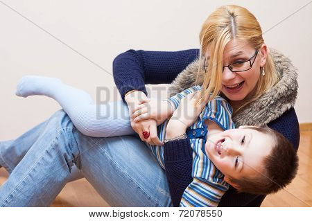 Playful Child Boy And Woman Laughing